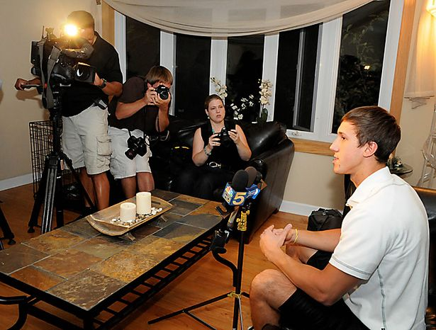 """Erik Sarnello of Itasca, Ill, a juror in the corruption trial of former Gov Rod Blagojevich, talks to reporters inside his home in Itasca Tuesday, Aug. 17, 2010. Sarnello, 21, said the panel was deadlocked at 11-1 in favor of convicting the former Illinois governor of trying to sell or trade President Obama's former Senate seat. Sarnello also stated that a female holdout, """"just did not see what we all saw"""" adding that the counts around the Senate seat were """"the most obvious.""""  (AP Photo/Lois Bernstein)"""