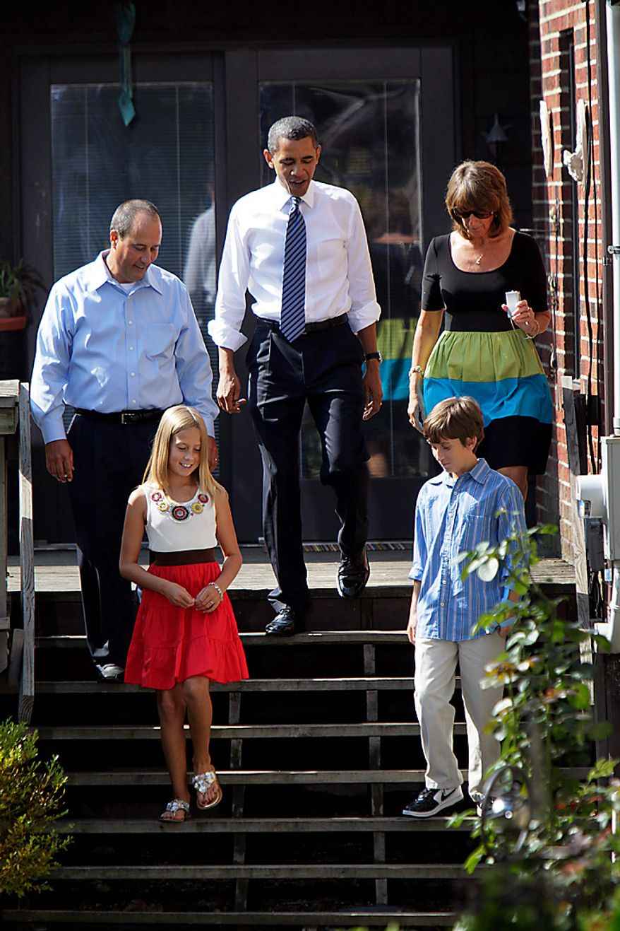 President Barack Obama walks with the Weithman family, from left, Rachel 9, Joe, Rhonda and Josh, 11, Wednesday, Aug. 18, 2010, in Columbus, Ohio. (AP Photo/Carolyn Kaster)