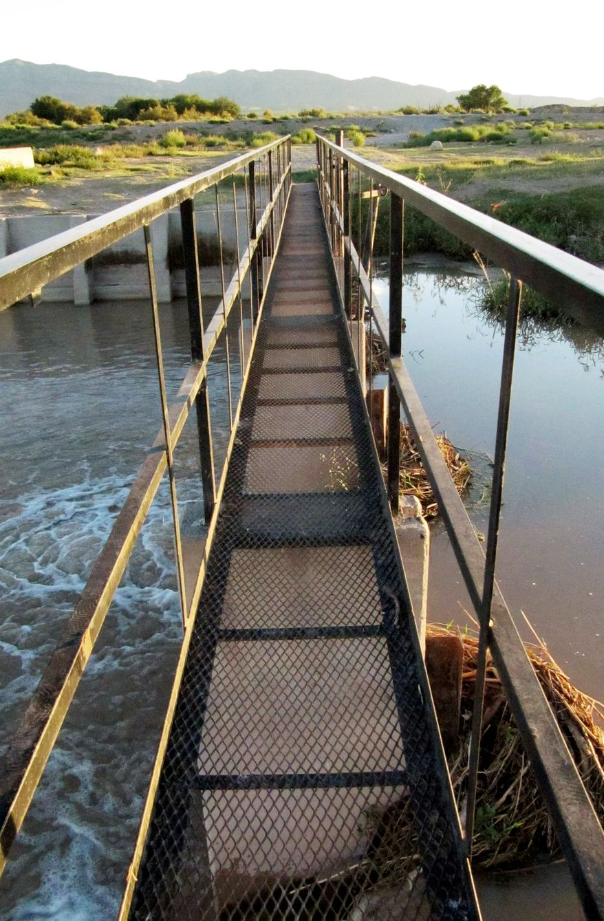 ASSOCIATED PRESS Texans are worried footbridges, like this one across the Rio Grande, are aiding illegal immigrants in entering the U.S.