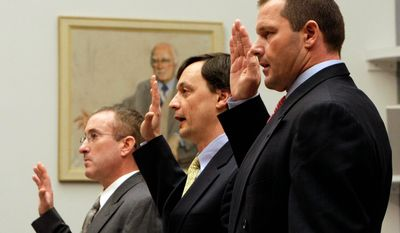 ASSOCIATED PRESS From right, former New York Yankees pitcher Roger Clemens, lawyer Charles Scheeler and his former personal trainer Brian McNamee, are sworn-in before Mr. Clemens' hearing on drug use in 2008. Mr. Clemens was indicted on charges of lying to Congress.