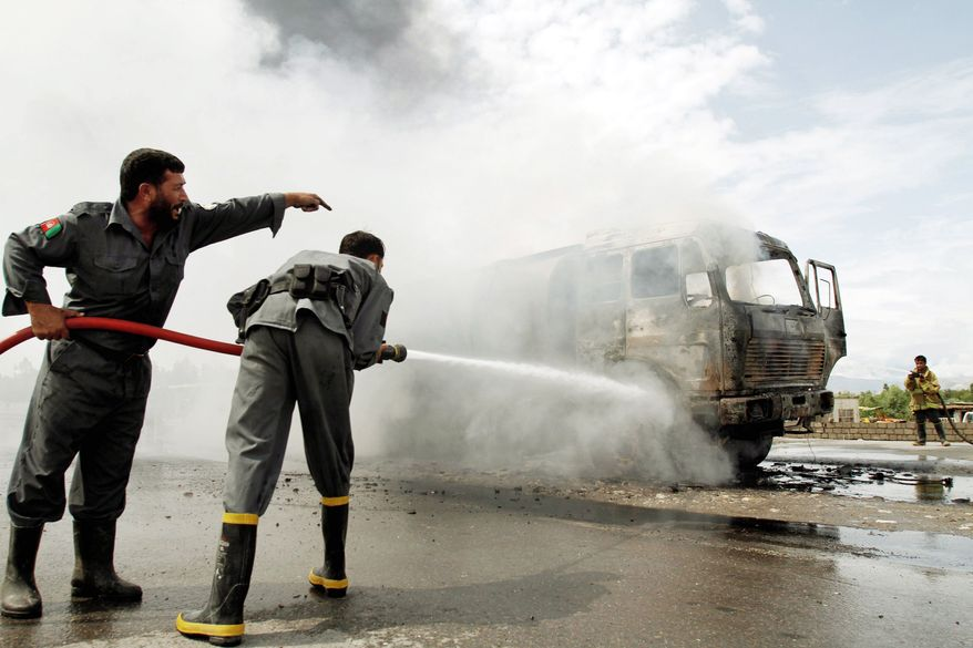 ASSOCIATED PRESS PHOTOGRAPHS At top, Afghan policemen watch a NATO vehicle burn in late July after a convoy was hit by a suicide attack in Jalalabad. Arab and other foreign fighters with ties to al Qaeda are infiltrating the mountains of eastern Afghanistan.Afghan firemen try to extinguish a burning oil tanker in early June after an explosive device planted under it exploded near a NATO air base in Jalalabad, east of Kabul.