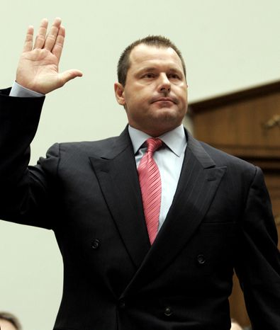 This Feb. 13, 2008, file photo shows former New York Yankees baseball pitcher Roger Clemens being sworn-in on Capitol Hill in Washington, prior to testifying before the House Oversight, and Government Reform committee hearing on drug use in baseball. The New York Times reported on its website Thursday, Aug. 19, 2010, that federal authorities have decided to indict Roger Clemens on charges of making false statements to Congress about his use of performance-enhancing drugs. (AP Photo/Susan Walsh, File)