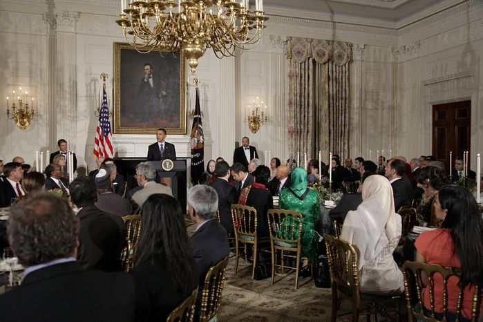 President Obama hosts an iftar dinner, the meal that breaks the dawn-to-dusk fast for Muslims during the holy month of Ramadan, in the State Dining Room at the White House in Washington, Friday, Aug. 13, 2010. (AP Photo/J. Scott Applewhite)