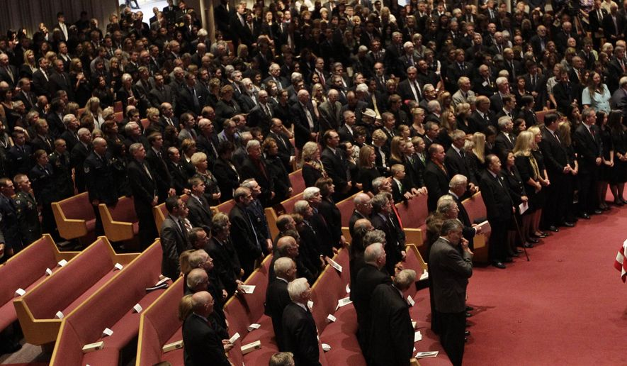 Mourners pay their respects to former Sen. Ted Stevens during funeral services at the Anchorage Baptist Temple on Wednesday, Aug. 18, 2010, in Anchorage, Alaska. (AP Photo/Rick Bowmer)