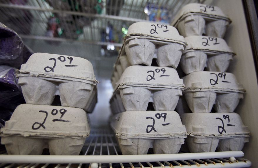 Cartons of fresh eggs are priced at a local market in Los Angeles on Wednesday, Aug. 18, 2010. Hundreds of people have been sickened in a salmonella outbreak linked to eggs in four states and possibly more, and health officials on Wednesday dramatically expanded a recall to 380 million eggs. (AP Photo/Damian Dovarganes)