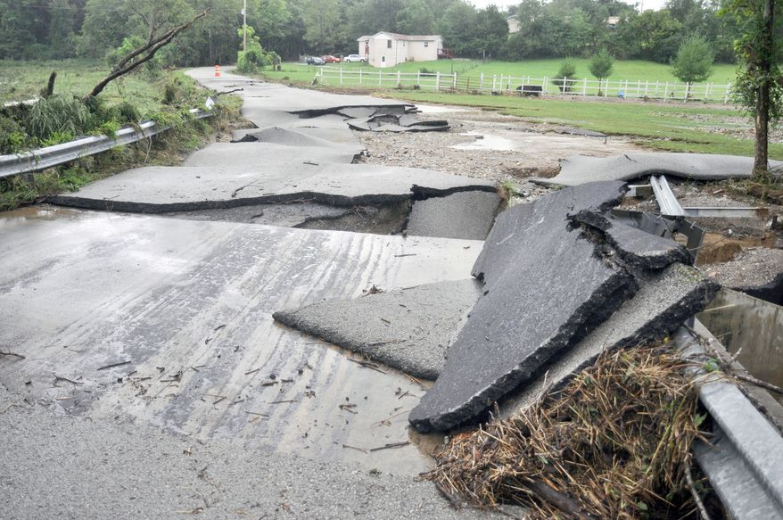 Dyer Long Road was one of several Putnam County roads destroyed by flood waters near Cookeville, Tenn., Wednesday, Aug. 18, 2010. (AP Photo/The Herald-Citizen,Ty Kernea)