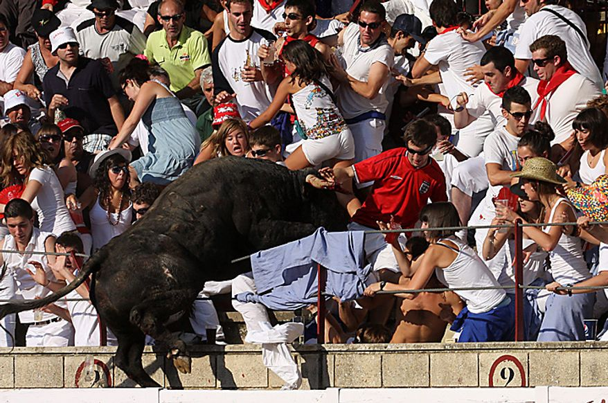 In this Wednesday, Aug. 18, 2010 picture made available Thursday, Aug 19. 2010 a bull leaps into the stands during a bullfight in Tafalla, northern Spain, on Wednesday, Aug. 18, 2010. Up to forty people were injured when a bull leapt into the packed grandstands of a Spanish bullring and ran amok, charging and trampling on spectators. (AP Photo/Manuel Sagues)