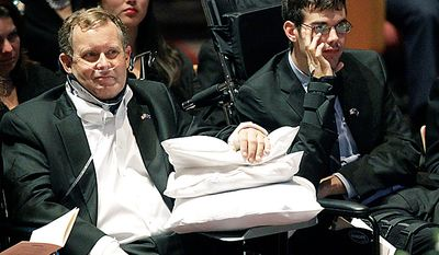 Plane crash surviviors Jim Morhard, left, and Kevin O'Keefe look on during funeral services for former U.S. Sen. Ted Stevens at the Anchorage Baptist Temple Wednesday, Aug. 18, 2010, in Anchorage, Alaska.  (AP Photo/Rick Bowmer)