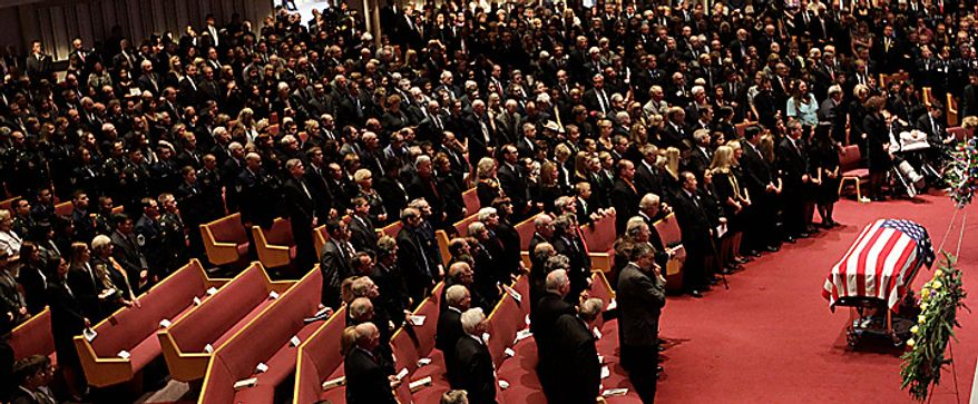 Mourners pay their respects to former U.S. Sen. Ted Stevens during funeral services at the Anchorage Baptist Temple Wednesday, Aug. 18, 2010, in Anchorage, Alaska.  (AP Photo/Rick Bowmer)