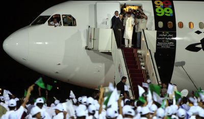 In this Aug. 20, 2009, file photo, hundreds of Libyans welcome Libyan Abdel Baset al-Megrahi, who found guilty of the 1988 Lockerbie bombing, top left, as he is accompanied by Seif al-Islam el- Gadhafi, son of Libyan leader Libyan leader Moammar Gadhafi upon his arrival at airport in Tripoli, Libya, after Scotland freed the terminally ill Lockerbie bomber on compassionate grounds. (AP Photo/Amr Nabil, File)