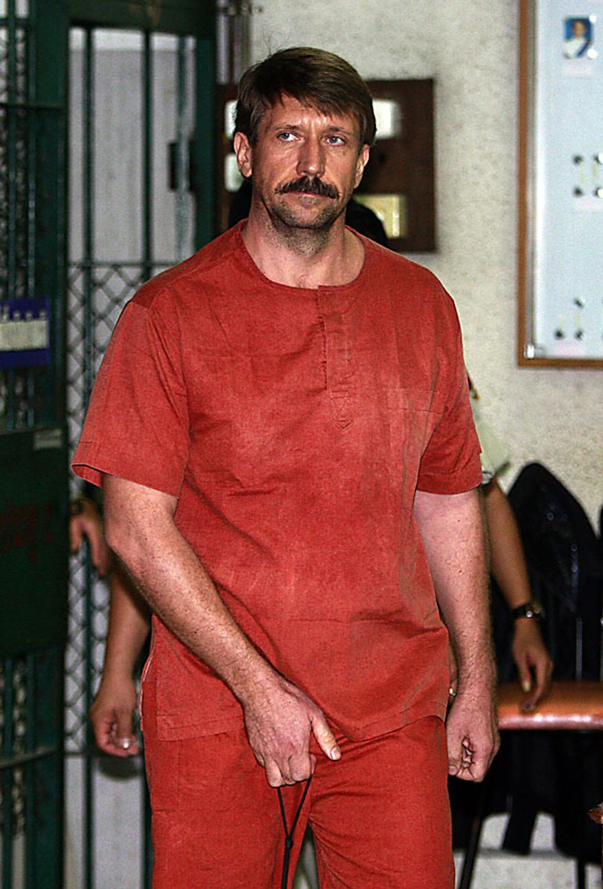 "Viktor Bout, a suspected Russian arms dealer, is led to a court room at the criminal court in Bangkok, Thailand Friday, Aug. 20, 2010. An appeals court backed a U.S. request to extradite the elusive Russian businessman dubbed ""The Merchant of Death."" (AP Photo/Apichart Weerawong)"