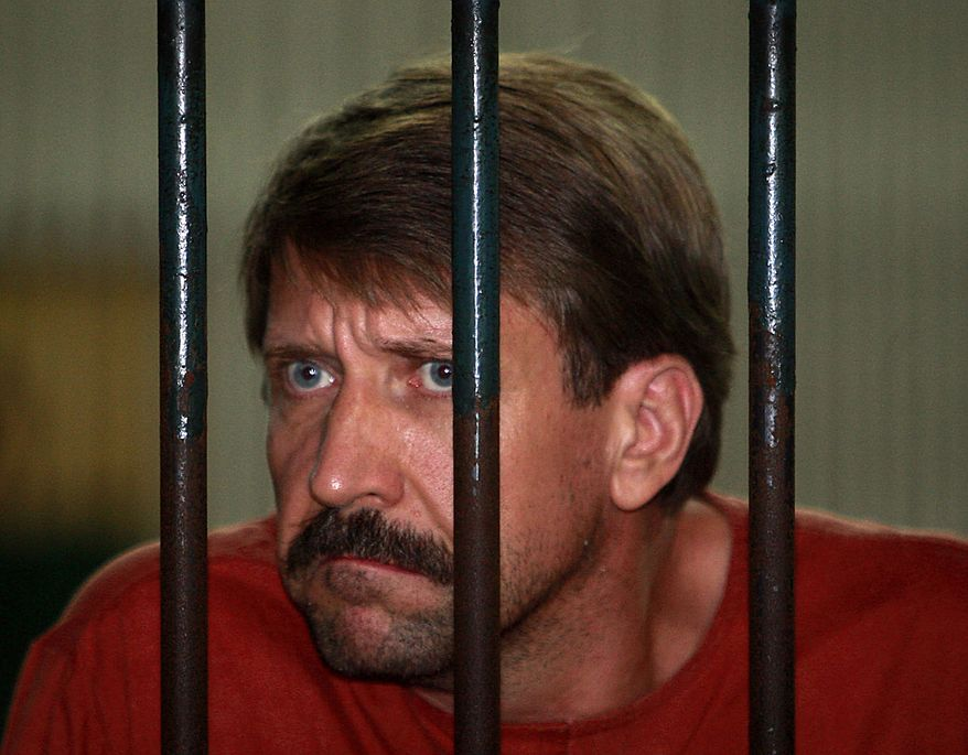 "Viktor Bout, a suspected Russian arms dealer, listens to reporter's questions from inside a court cell at the criminal court in Bangkok, Thailand Friday, Aug. 20, 2010. An appeals court ruled in favor of a U.S. request to extradite the elusive Russian businessman dubbed ""The Merchant of Death."" (AP Photo/Apichart Weerawong)"