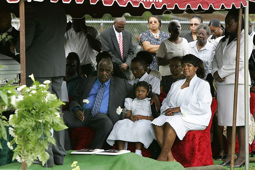 Arthur Duley, left, comforts his granddaughter Saniya Duley at her brothers' graveside service as her grandmother Helen Duley, right, looks at the caskets of Devean Duley,2 and Ja'van Duley, 18 months, Friday, Aug. 20, 2010, at Heavenly Rest Memorial Park in Orangeburg, S.C.  (AP Photo/Mary Ann Chastain)
