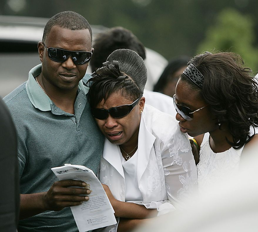 Family members console each other after leaving the funeral service of Devean Duley,2 and Ja'van Tyrell Duley, 18 month, Friday, Aug. 20, 2010, at St. Paul Baptist Church in Orangeburg, S.C. The boys' 29-year-old mother, Shaquan Duley, was not allowed to attend. Investigators say she confessed to smothering her children Sunday night then staging a car accident to cover up the deaths. (AP Photo/Mary Ann Chastain)