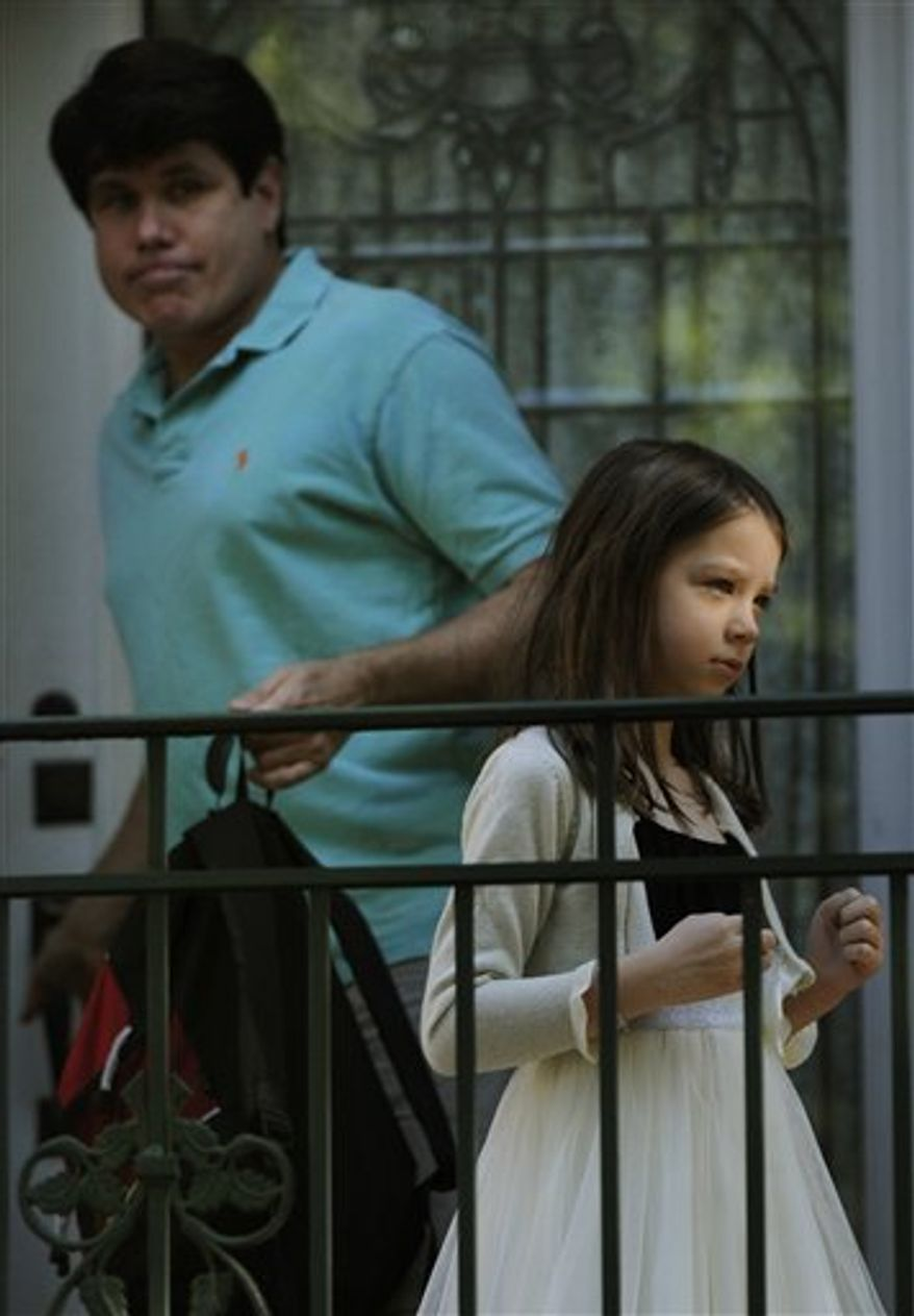 Former Illinois Gov. Rod Blagojevich leaves his home to take his daughter Annie to camp in Chicago, Wednesday, Aug. 18, 2010. A day after hearing the verdict in his political corruption trial, Blagojevich was on dad duty, taking his younger daughter to camp. (AP Photo/Paul Beaty)