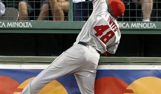 Los Angeles Angeles right fielder Torii Hunter jumps to catch a deep fly ball by Boston Red Sox's Adrian Beltre during the second inning of a baseball game at Fenway Park in Boston on Tuesday, Aug. 17, 2010. (AP Photo/Elise Amendola)