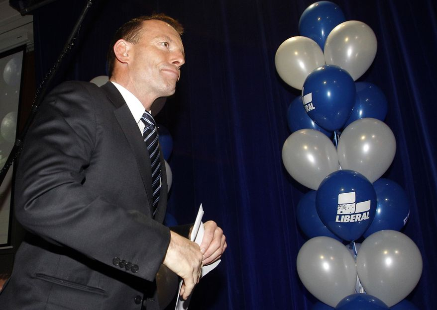 Liberal party leader Tony Abbott arrives on stage at a hotel in Sydney, Australia, Saturday, Aug. 21, 2010 on election night to address supporters. Australians chose Saturday between giving their first female prime minister her own election mandate and returning to a conservative government after just three years. With more than 75 percent of the votes counted, the results were too close to call. (AP Photo/Rob Griffith)
