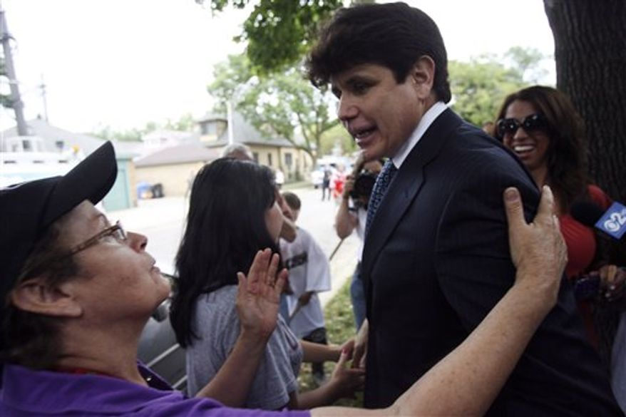 Former Gov. Rod Blagojevich stands on the porch of his home on the north side of Chicago after being convicted on one of 24 counts in his federal corruption trial on Tuesday Aug. 17, 2010.  (AP Photo/Eric Y. Exit)