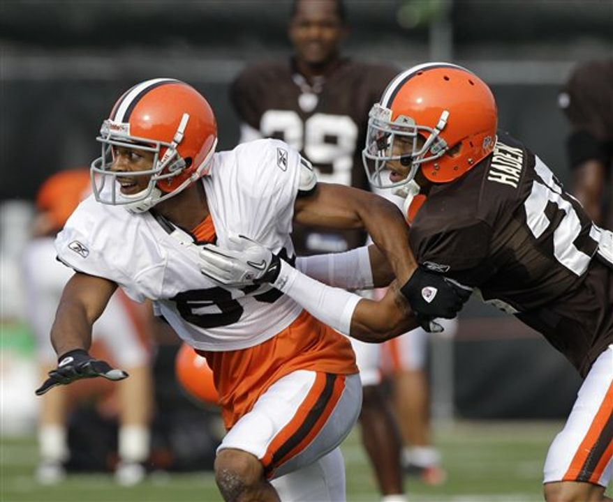 Cleveland Browns cornerback Joe Haden grabs a pass during practice at the NFL football team's training camp Thursday, Aug. 19, 2010, in Berea, Ohio. (AP Photo/Mark Duncan)