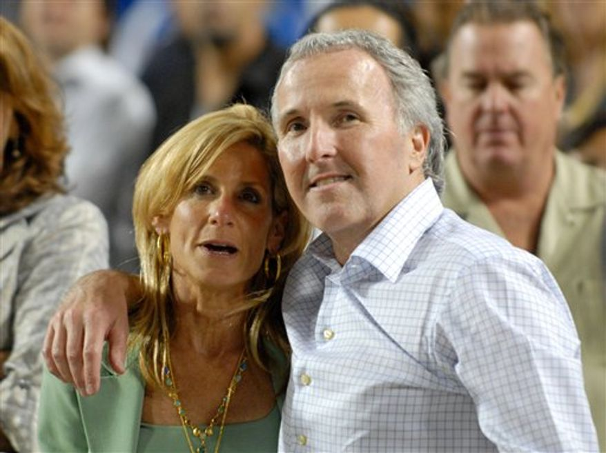FILE - In this Sept. 25, 2008 photo, Los Angeles Dodgers owner and chairman Frank McCourt and his wife Jamie McCourt after the Dodgers' baseball game against the San Diego Padres in Los Angeles.  (AP Photo/Carlos Delgado)