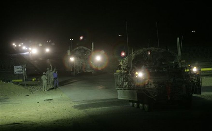 The last in a convoy of U.S. Army Stryker armored vehicles leave Iraq at the Khabari border crossing into Kuwait, Thursday, Aug. 19, 2010. The U.S. Army's 4th Brigade, 2nd Infantry Division is the last combat brigade to leave Iraq as part of the drawdown of U.S. forces.  (AP Photo/ Maya Alleruzzo)