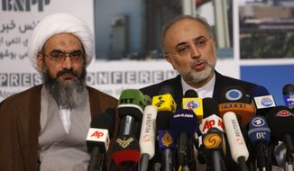 ** FILE ** Ali Akbar Salehi (right), head of Iran's Atomic Energy Organization, speaks with media during a press conference as cleric Gholamali Safaei Bushehri looks on at the Bushehr nuclear power plant outside the southern Iranian city of Bushehr on Saturday, Aug. 21, 2010. (AP Photo/Vahid Salemi)