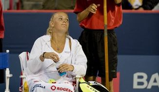 Caroline Wozniacki from Denmark holds up the trophy after beating Vera Zvonareva from Russia in the final at the Rogers Cup tennis tournament Monday, Aug.  23, 2010 in Montreal. (AP Photo/The Canadian Press,Paul Chiasson)