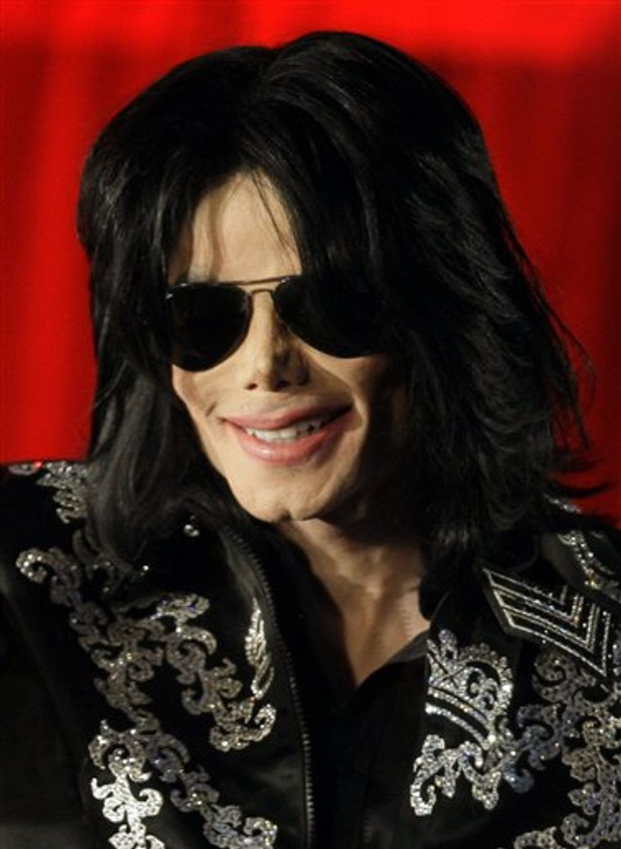 FILE - In this March 5, 2009 file photo, US singer Michael Jackson is shown at a press conference in London.  (AP Photo/Joel Ryan, file)