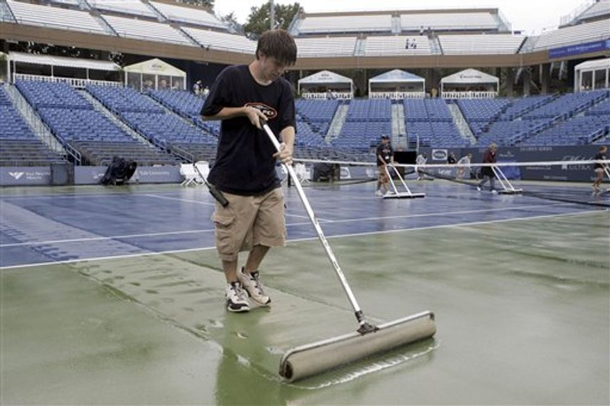 FILE - In this Aug. 25, 2006 file photo, members of the grounds crew start drying out the stadium court at the Connecticut Tennis Center in New Haven, Conn., preparing it for play in the Pilot Pen Tennis tournament.  The  2010 professional tennis stop could be the city's last unless a new sponsor steps forward to replace the pen manufacturer, which is dropping its sponsorship of the event after 14 year.  (AP Photo/Bob Child, File)
