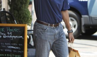 President Barack Obama waves to a crowd as he leaves the Bunch of Grapes book store in Vineyard Haven, Mass., on Friday, Aug. 2010, where the first family is vacationing. (AP Photo/Carolyn Kaster)