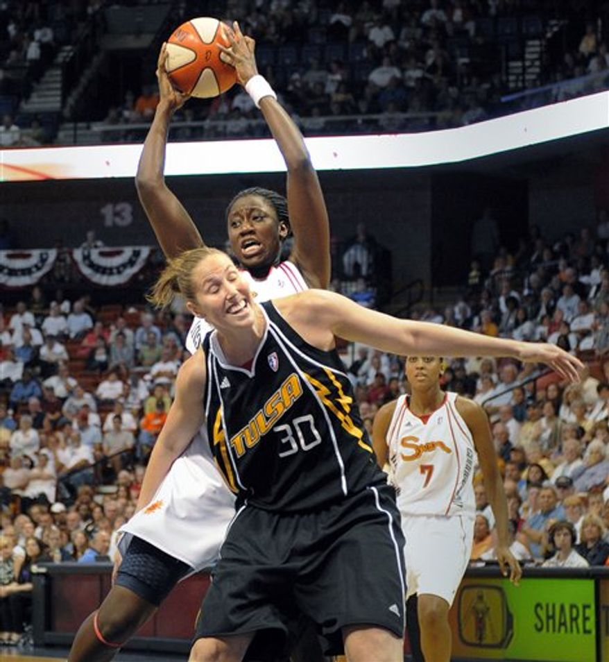Tulsa Shock's Marion Jones, right, shoots over Connecticut Sun's Renee Montgomery during the first half of their WNBA basketball game in Uncasville, Conn., on Tuesday, Aug. 17, 2010. (AP Photo/Fred Beckham)