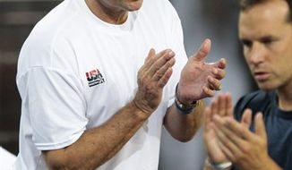 The United States' head coach Mike Krzyzewski gestures during a friendly basketball game against Spain in Madrid on Sunday, Aug. 22, 2010. (AP Photo/Daniel Ochoa de Olza)
