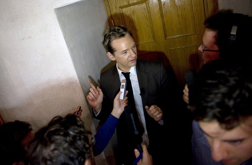** FILE ** WikiLeaks founder Julian Assange is approached by the media after giving a seminar at the Swedish Trade Union Confederation headquarters in Stockholm, Sweden, Saturday Aug. 14, 2010. (AP Photo / Bertil Ericson / SCANPIX)