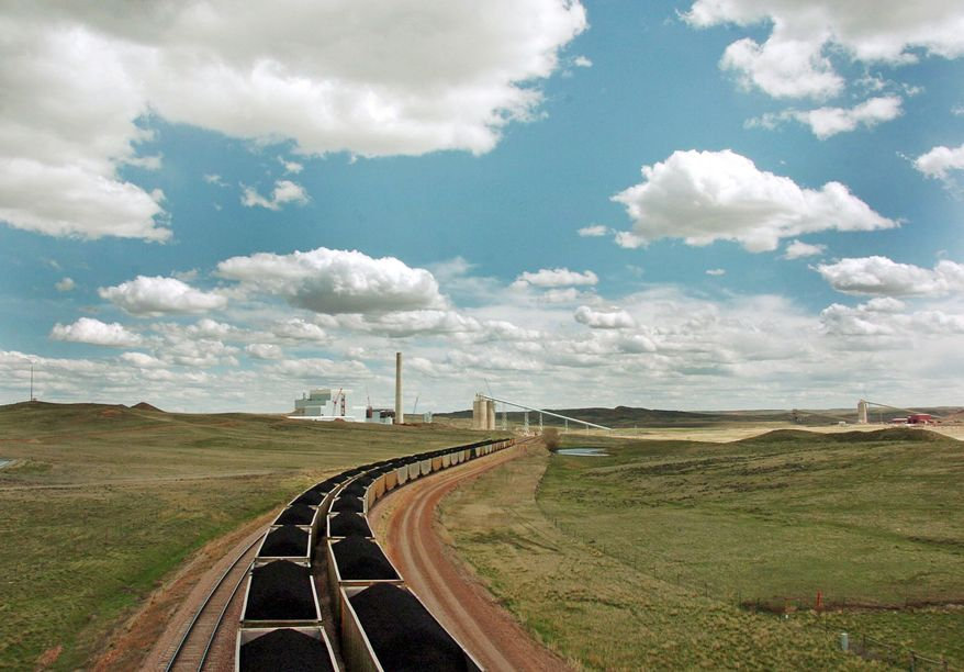 """Trainloads of coal are sent to the Basin Electric Power Cooperative's Dry Fork Station power plant being built near Gillette, Wyo. The largest expansion of traditional coal plants in two decades represents an acknowledgment that highly touted """"clean coal"""" technology is still a long way from becoming a reality. (Associated Press)"""
