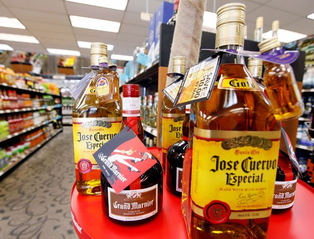 ** FILE ** The holidays often mean an excess of booze and drugs. (Associated Press)