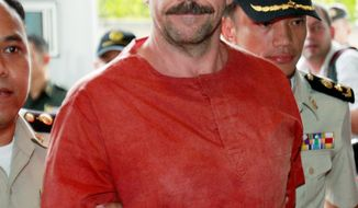 Viktor Bout, a suspected Russian arms dealer, arrives at court in Bangkok on Friday to hear an appeals court extradition decision requested by the U.S. (Associated Press)