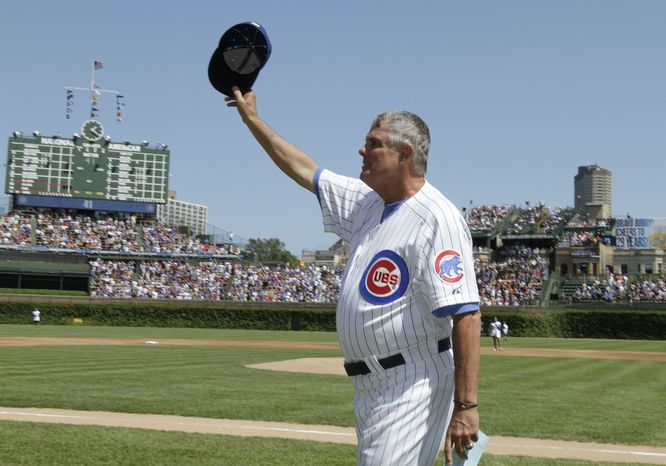ASSOCIATED PRESS Chicago Cubs manager Lou Piniella waves to the crowd as he walks to the dugout before the start of a baseball game against the Atlanta Braves, Sunday, Aug. 22, 2010, in Chicago. Piniella says he is retiring after the game so he can spend more time with his family. The 66-year-old manager made the announcement in a release handed out by the team before the game.