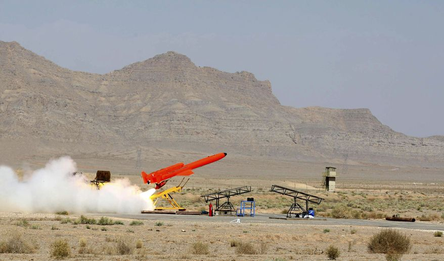"""This photo, released on Sunday, Aug. 22, 2010, by the Iranian Defense Ministry, reportedly shows the launch at an undisclosed location of the Karrar drone aircraft, which Iran says is the country's first domestically built, long-range, unmanned bomber aircraft. Iranian President Mahmoud Ahmadinejad called it an """"ambassador of death"""" to Iran's enemies. (AP Photo/Iranian Defense Ministry, Vahid Reza Alaei)"""