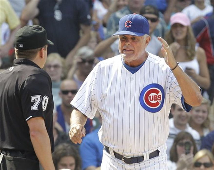 Chicago Cubs manager Lou Piniella appeals to home plate umpire D.J. Reyburn after Reyburn called San Diego Padres' Will Venable safe at home during the seventh inning of a baseball game Thursday, Aug. 19, 2010 at Wrigley Field in Chicago. The Cubs lost 5-3. (AP Photo/Charles Rex Arbogast)