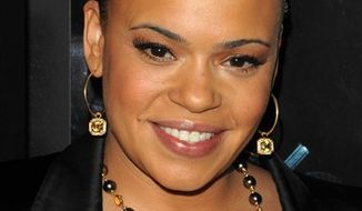 """In this Jan. 7, 2009 photo singer Faith Evans attends the premiere of """"Notorious"""" in New York. The Grammy-winning Evans was arrested on suspicion of misdemeanor drunken driving, after being stopped in the Marina del Rey section of Los Angeles on Saturday, Aug. 21, 2010. (AP Photo/Peter Kramer)"""