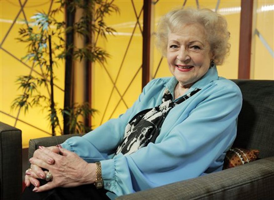 """FILE - In this Nov. 24, 2009 file photo, actress Betty White poses for a portrait following her appearance on the television talk show """"In the House,"""" in Burbank, Calif. (AP Photo/Chris Pizzello, File)"""