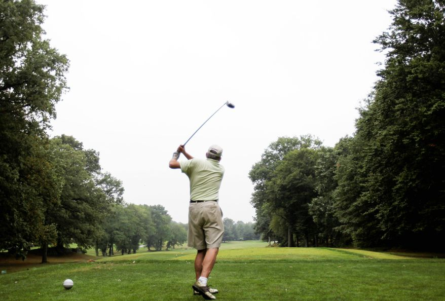 """Greg Schimoler, teeing off at the Saxon Woods golf course in Scarsdale, N.Y., says clubs need to do more to bring back membership. """"The social life kids have today is not the country club lifestyle,"""" he said. (Associated Press)"""