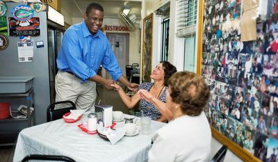 PRIMARY CONCERN: Rep. Kendrick B. Meek greets diners Monday at the West Tampa Sandwich Shop in his last-ditch effort to fend off another businessman and political newcomer, Jeff Greene, in Florida's Democratic Senate primary Tuesday. Alaska, Arizona and Vermont also hold primaries Tuesday. (Associated Press)