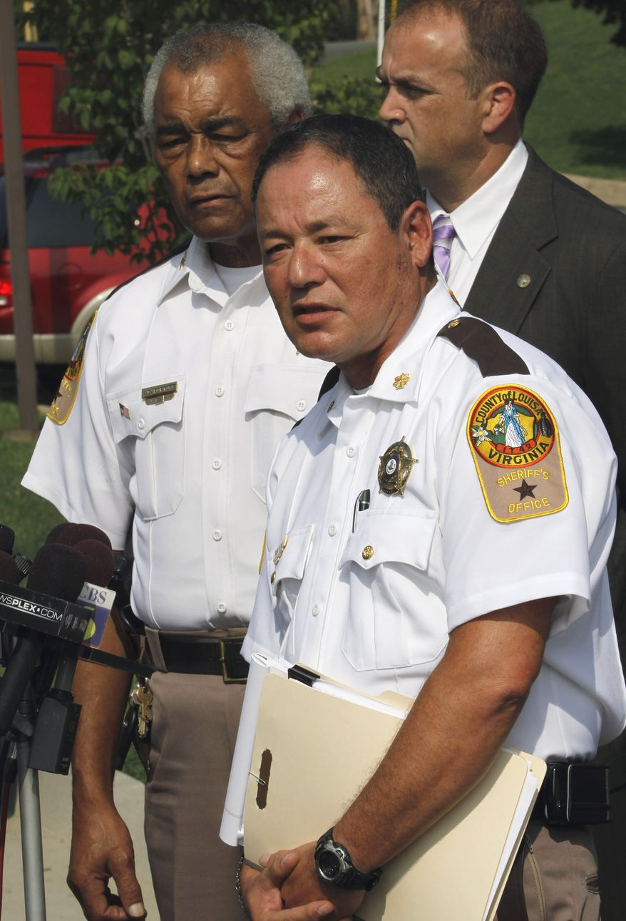 Maj. Donald Lowe (right), chief deputy of the Louisa County Sheriff's Department, speaks during a news conference along with Sheriff Ashland Fortune (left) in Louisa, Va., on Monday, Aug. 23, 2010. A gunman opened fire Sunday during a domestic dispute, killing two people and injuring four others before he was killed by police. (AP Photo/Steve Helber)