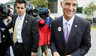 Associated Press photographs THIRD WAY: Florida Gov. Charlie Crist, independent candidate for Senate, speaks to reporters after voting Tuesday in St. Petersburg.