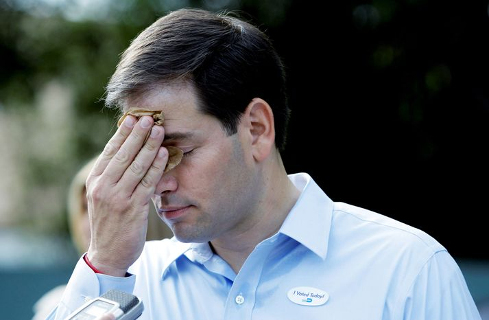 SWEATING IT OUT: Marco Rubio pauses while being interviewed after voting in West Miami, Fla., in Tuesday's primary. Mr. Rubio, GOP candidate for Senate, will face two rivals in the fall.