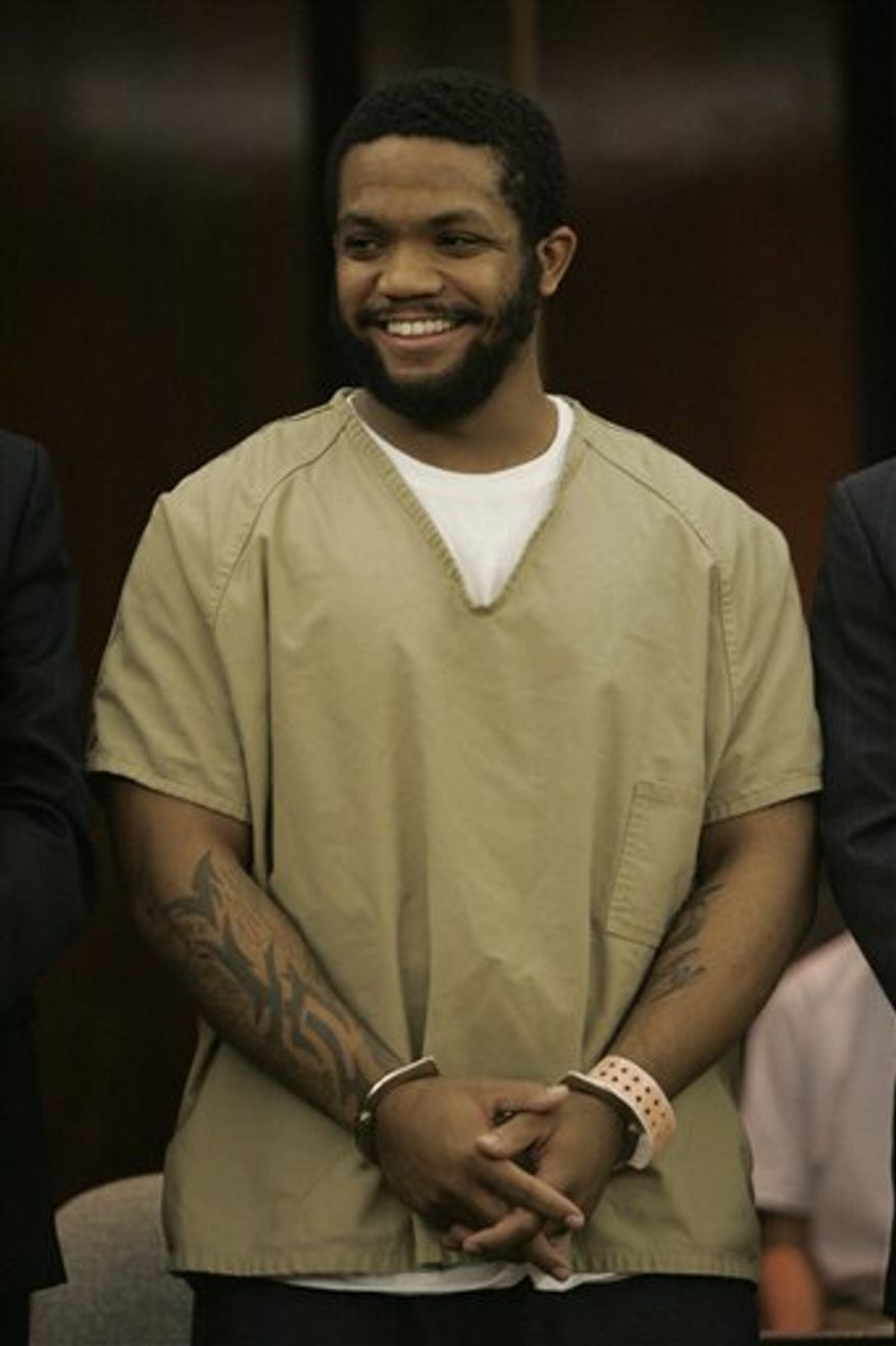 FILE-This Sept. 18, 2006 file photo shows former Ohio State football star Maurice Clarett smiling after pleading guilty in Columbus, Ohio to aggravated robbery and carrying a concealed weapon in a deal that will send him to prison for at least 3 1/2 years to end two criminal cases against him. Clarett is asking a judge to allow him to travel to try out with the Omaha Nighthawks  football team of the United Football League.  (AP Photo/Kiichiro Sato,File)