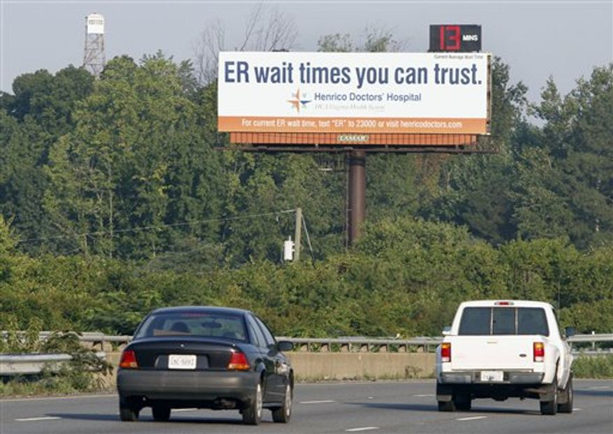 A billboard advertising emergency room wait times is seen along Interstate 64 near downtown Richmond, Va., Friday, Aug. 20, 2010.  ER visits hit a new high of more than 123 million in 2008, up from 117 million a year earlier, says preliminary data released this month by the Centers for Disease Control and Prevention. Online, via text message or flashing on a billboard, some emergency rooms are advertising how long the dreaded wait for care will be, with estimates updated every few minutes.  (AP Photo/Steve Helber)