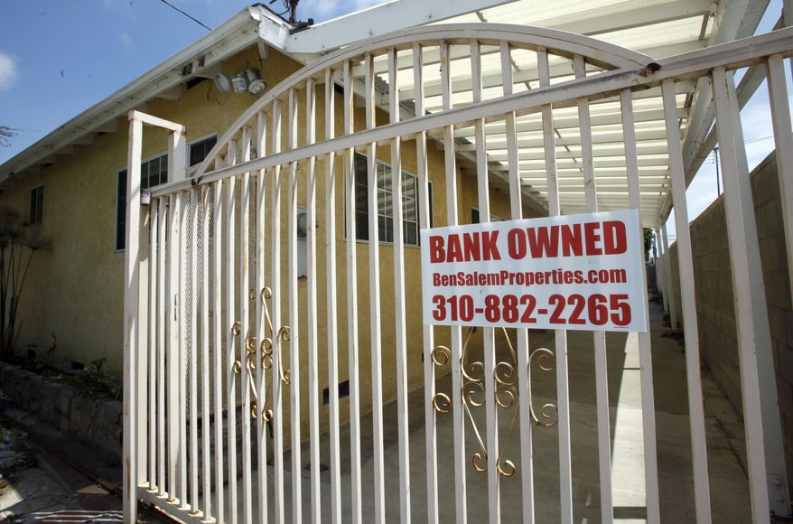 """**FILE** In this photo from July 21, 2010, a """"bank owned"""" sign is seen on a home that is listed as a foreclosure on a HUD website, in Hawthorne, Calif. Nearly half of the homeowners who enrolled in the Obama administration's flagship mortgage-relief program have fallen out. (Associated Press)"""