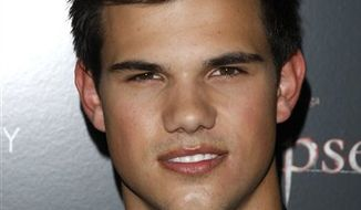 """FILE - In this June 28, 2010 photo,  Actor Taylor Lautner attends the Cinema Society premiere of """"The Twilight Saga: Eclipse"""" in New York.   Lautner is suing an RV dealership he claims didn't deliver a customized ride in time for him to use it on his current movie shoot.  The star of the """"Twillight"""" series sued the Irvine, Calif. dealership of McMahon's RV for more than $300,000 in Los Angeles on Monday, Aug. 23, 2010. The lawsuit claims McMahon's missed a deadline to deliver a customized 2006 Affinity Country Coach RV by June 21.  (AP Photo/Peter Kramer)"""